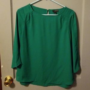 The limited green blouse medium